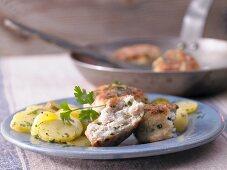 Fish patties with potato salad