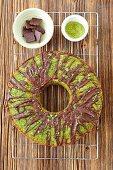 Sweet spinach cake with matcha tea and chocolate glaze