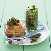 Pesto and bread with a topping
