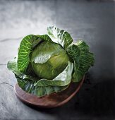 A head of cabbage on a wooden board