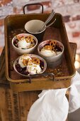 Caramel ice cream with cherry compote and salty pretzel-shaped biscuits