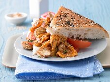 Scrambled egg with mushrooms served with flatbread and tomatoes
