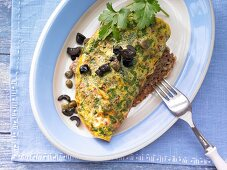 A tomato and herb omelette on pumpkin seed bread