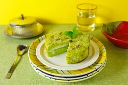 A potato cake with fresh pesto and a cheese filling