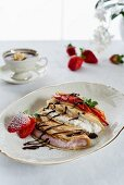 Pancakes with fresh cheese, berry quark, fresh fruits and chocolate sauce