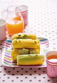 Corn on the cob with pesto & butter flowers