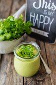 Watercress soup in a glass jar