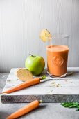 A glass of carrot, apple and ginger juice