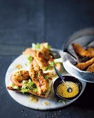 Chicken fillets with an almond coating on baguette halves with honey & mustard dressing