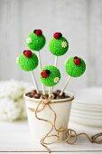 Cake pops decorated with fondant ladybugs