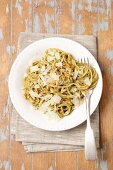 Spaghetti with pesto and pine nuts