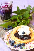 Pancakes with blueberry jam and cream