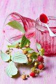 Empty jam jars with raspberry jam remnants