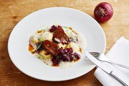 Braised beef cheeks with celeriac ravioli and onion confit