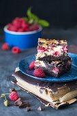 Cheesecake brownie bars with raspberries on a plate