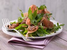 Rocket salad with Parma ham and caper dressing