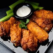 Buffalo chicken wings with garlic, celery and ranch dressing