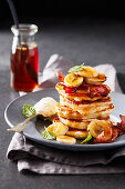 Fried banana, bacon and ricotta flapjack stack