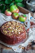 Apple and chocolate cake with nuts and pistachios