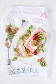 A triple layer ice cream terrine with kiwi, vanilla, and strawberry ice cream (top view)