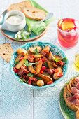 Fried potatoes with chorizo, peppers and parsley