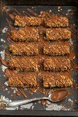 Homemade flapjacks coated with chocolate