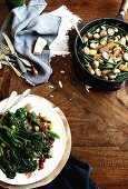 Pan-fried potatoes with green beans and pesto and broccolini with crispy Prosciutto