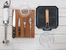 Various kitchen utensils: blender, cutlery, juicer and griddle