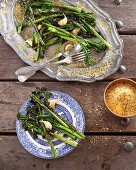 Broccolini florets with garlic and crumbled pecan nuts