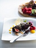 Gluten-free chocolate cake with ganache and marscapone and macadamia cream