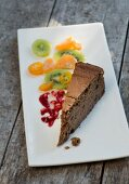A slice of chestnut cake with citrus fruit