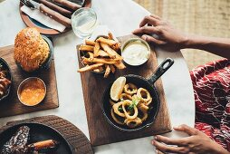 Fried calamari rings with chips and flowerpot bread at the Potato Shed restaurant (Johannesburg, South Africa)