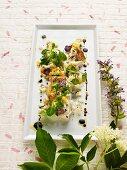 Lukewarm marinated asparagus with radish, eggs and elderflower