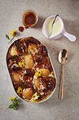 Bread and butter pudding with poached pears and caramel