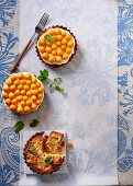 Almond tartlets with orange cream and physalis