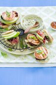 Small pita sandwiches with cream cheese, bacon, Emmental cheese and Granny Smith apple