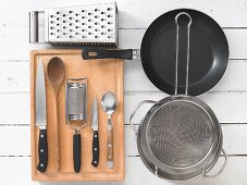 Kitchen utensils for the preparation of Spätzle (soft egg noodles from Swabia) with mushrooms and cheese