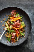 Salad of curer veal tongue with lentils, carrot and celery