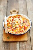 A quiche with pumpkin and peppers