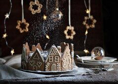 A Christmas cake in a ring of gingerbread houses
