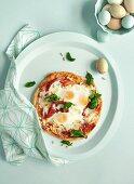 Bismarck pizza with ham, mozzarella and eggs
