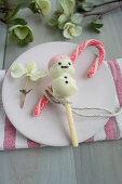 Stollen cake pop snowmen covered in white chocolate