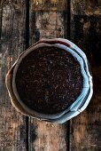 Mixture for spelt and amaretto fruit cake in a baking tin