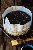 Spelt, amaretto and fruit cake in a baking tin