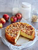 A vanilla quark cake with cranberries, apple and crunchy nut topping