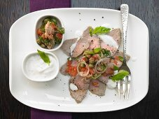 Vitello tonnato with tomatoes and capers
