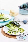 Individual caesar salads with green peas, soft boiled organic egg and kale chips