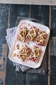 Vegan raspberry crumble cake slices with vanilla cream