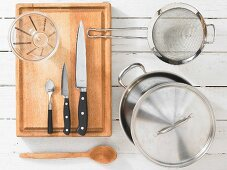 Kitchen utensils for making basmati rice with carrots and chives