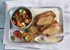 Bruschetta with tomato compote and mini mozzarella balls